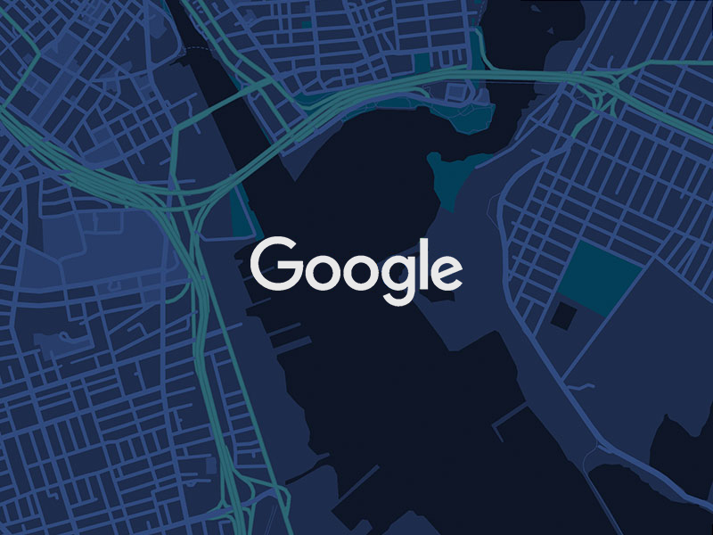 Google logo in white with dark mode Google Maps background